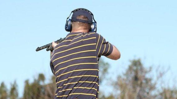 Man holding gun at shooting range