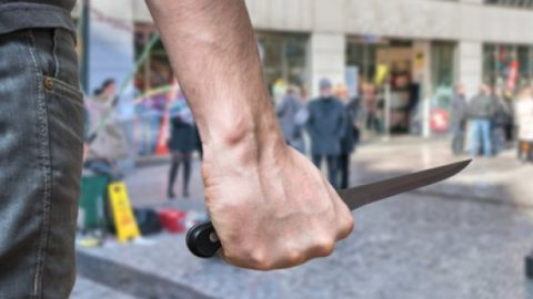Holding knife in a public place