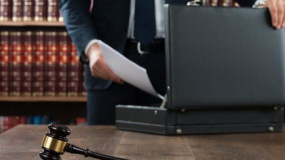 Lawyer, gavel, and briefcase
