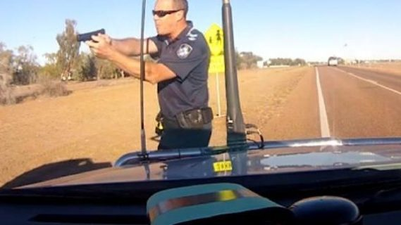 Bully cop pointing gun