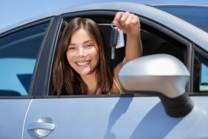 Young girl holding car keys