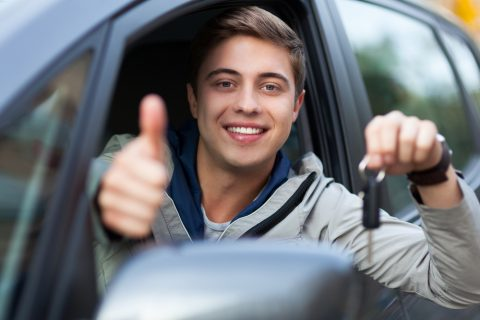 Young male driver doing a thumbs up