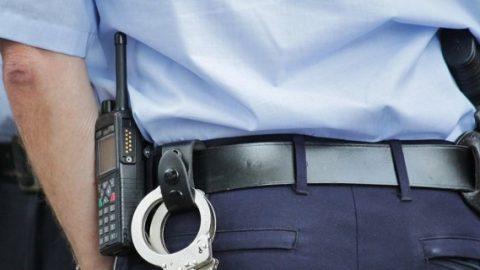 Police officer wearing radio