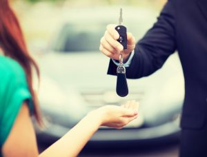 Traffic lawyer giving back client her car keys