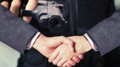 Handshake agreement and a pointed gun