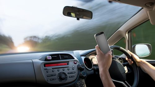 Texting with mobile phone while driving
