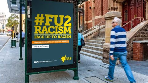 Face up to racism advert on bus stop