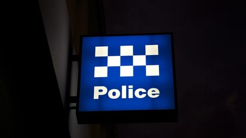 Police station sign at night