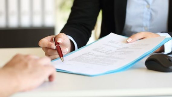 Woman lawyer giving contract to client