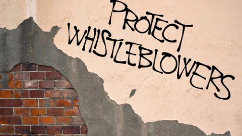 Protect whistleblowers written in graffiti