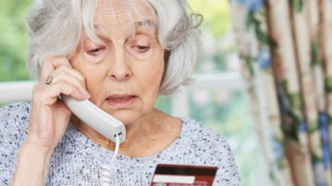Elderly woman on phone to a scammer