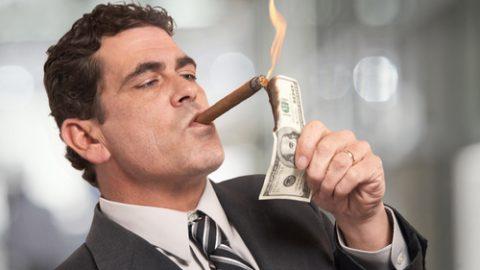 Greedy boss smoking cigar