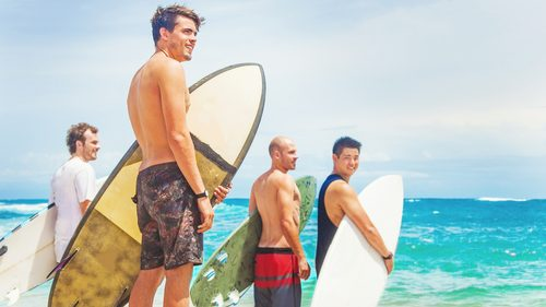 Surfers beach and surfboards