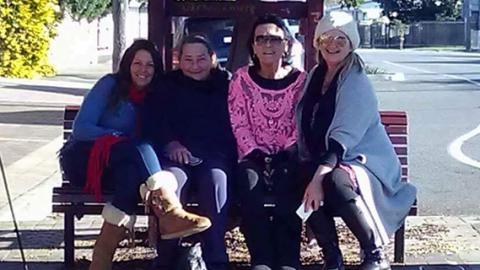 Grandmothers sitting on bench