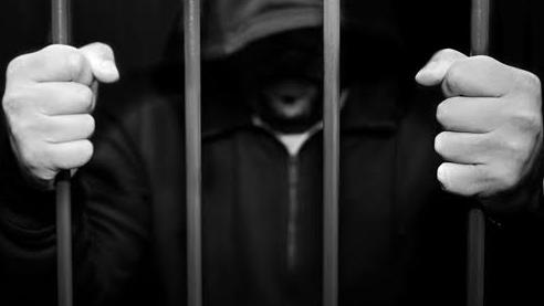 Hooded prisoner
