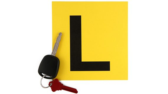 Learner driver l plate and car keys