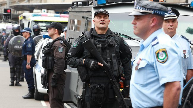 Police officers with semi automatic weapons