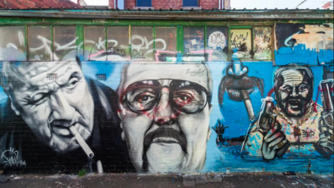 Graffiti of criminals on a wall