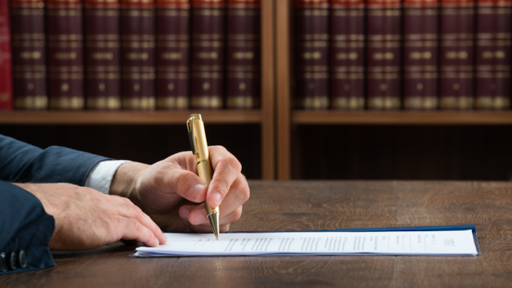 Lawyer writing with a pen