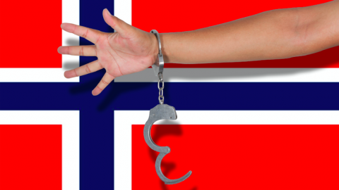 Norway flag and arm handcuffed