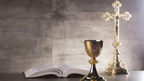 Catholic Church's bible, cross, and goblet