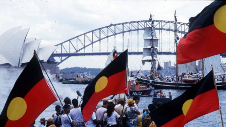 Justice treaty and Aboriginal flags