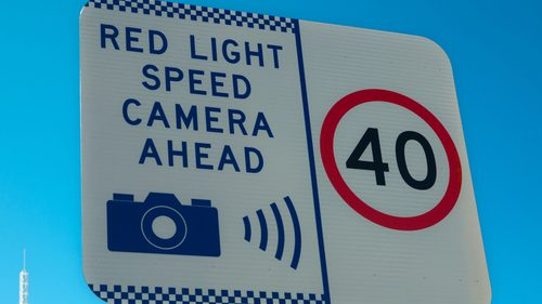 Speed camera warning signs