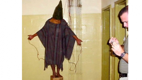 Tortured hooded man