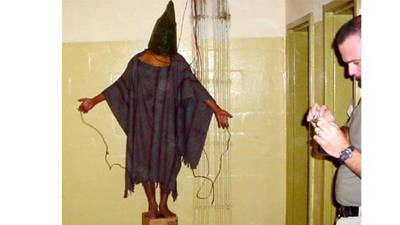 Tortured hooded man