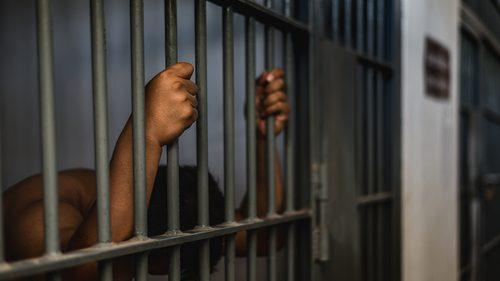 Black man in prison
