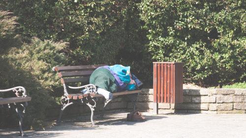 Homeless man on bench